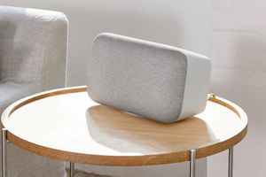 A Google Home Max smart speaker on a table