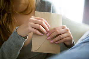 Woman holding envelope