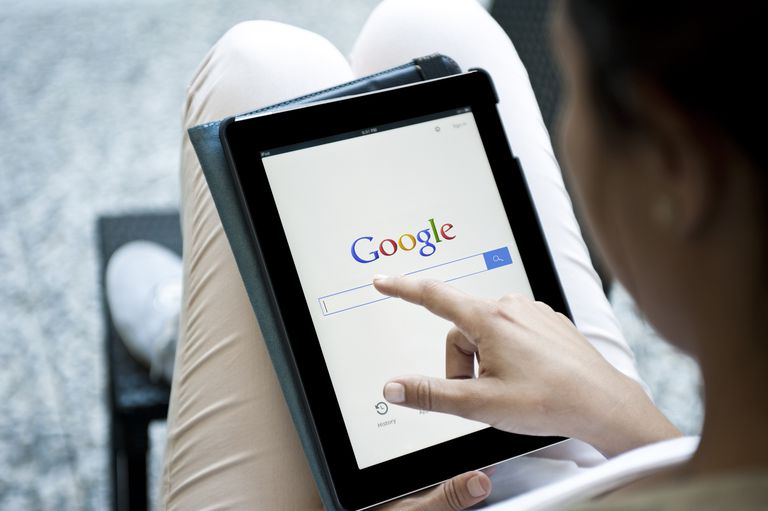 Woman using Google on tablet device