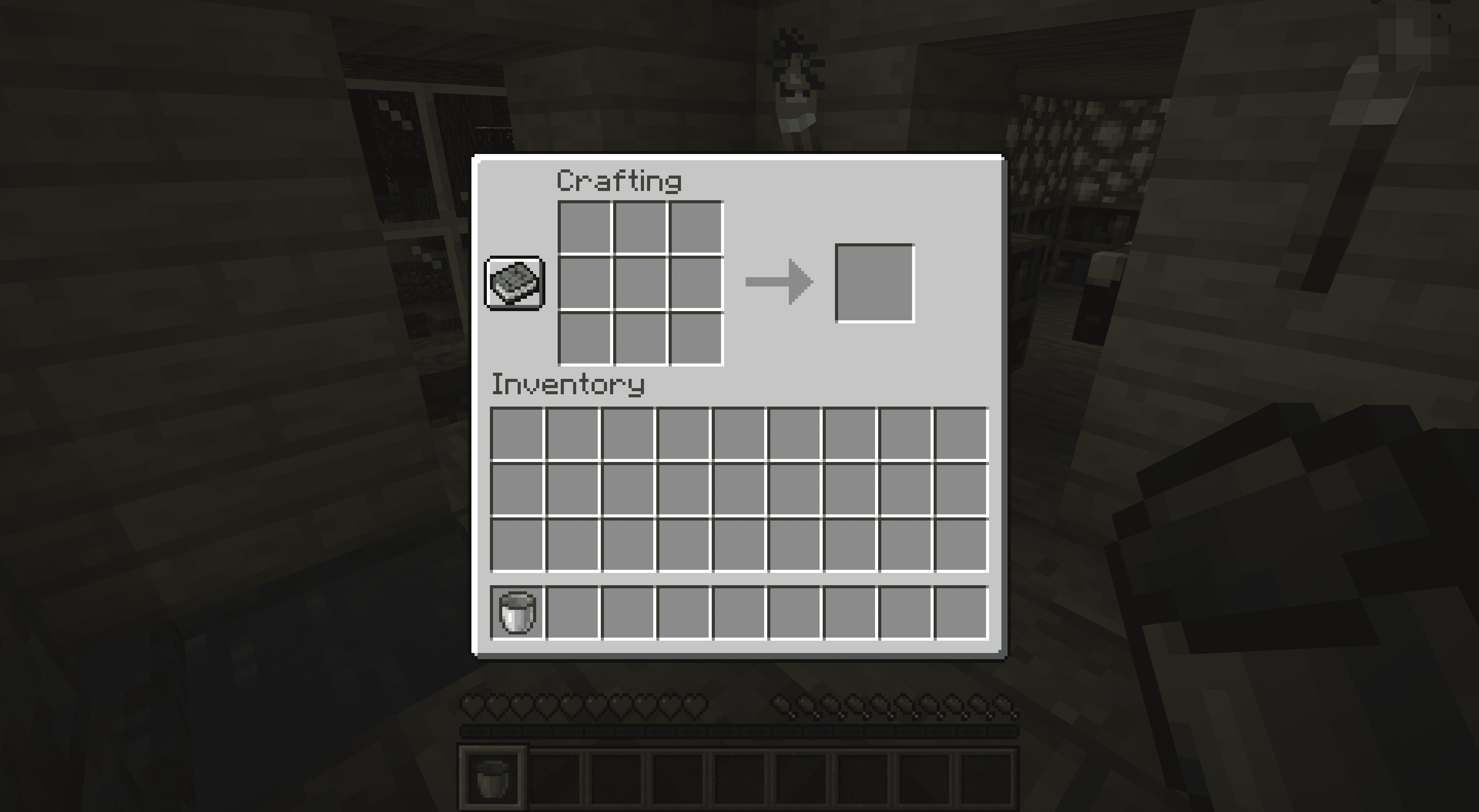 Moving a crafted bucket into inventory in Minecraft.