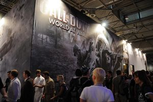 People walking in front of a giant wall ad for Call of Duty: World at War