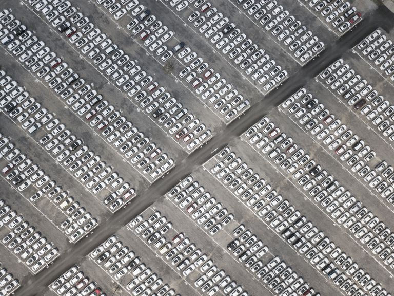 Arial view of hundreds of cars parked in a parking lot