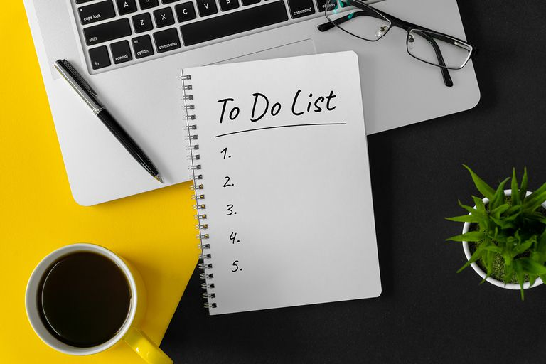 To Do List on Notebook Page With Laptop and Coffee Mug