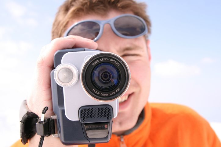 Man holding a video camera