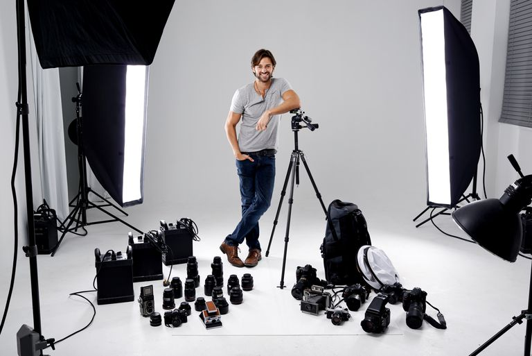Photographer in studio with equipment
