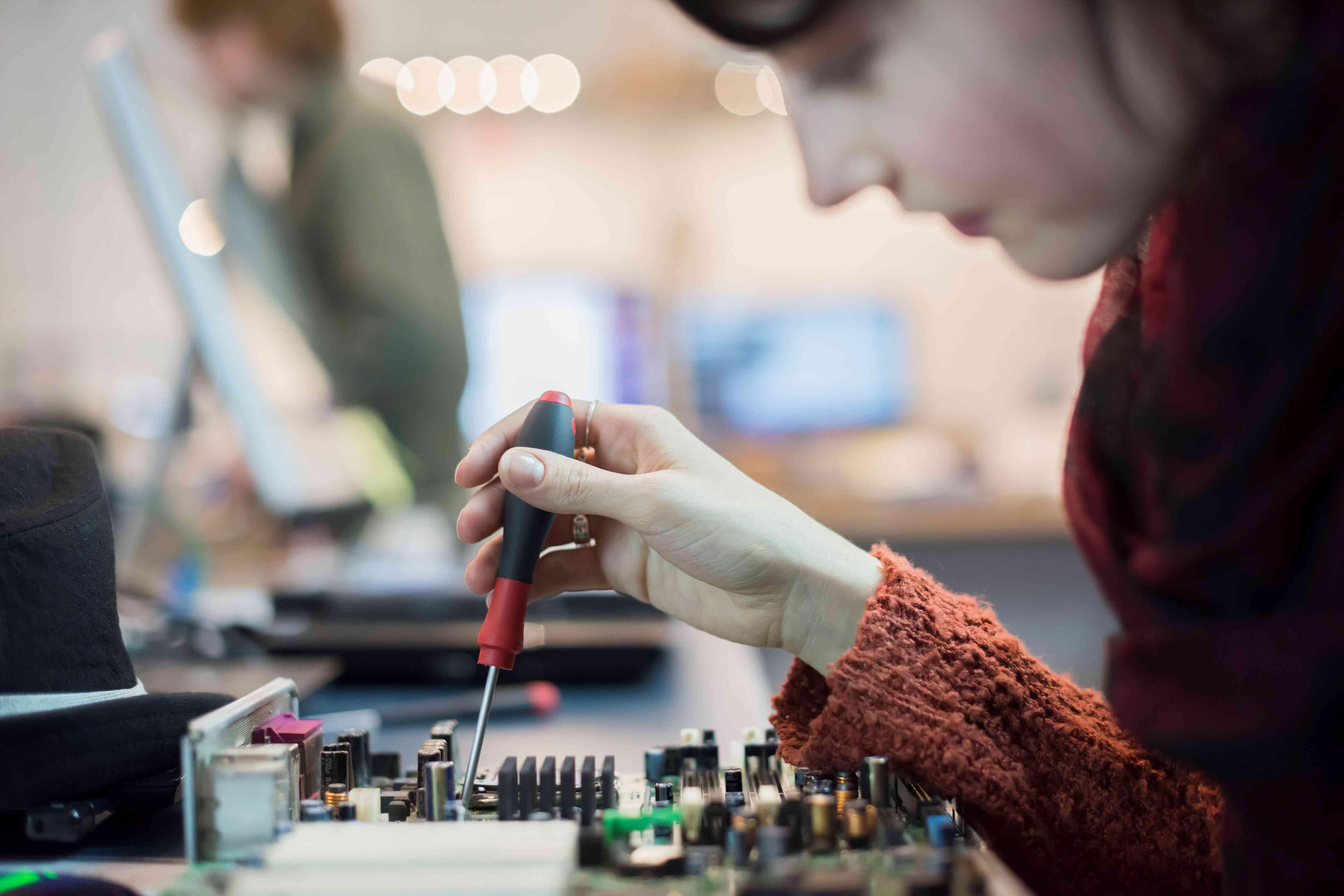 Repair technician working on a computer in a computer repair shop