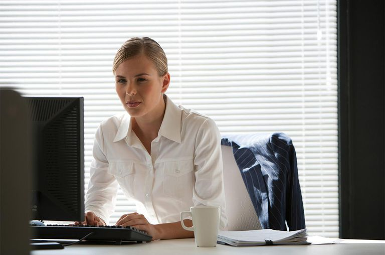 Businesswoman at desk with computer