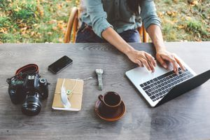 Female blogger writing on the laptop
