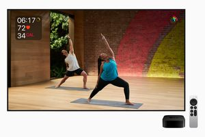 Apple TV 4K next to a television screen displaying an Apple Health yoga video.