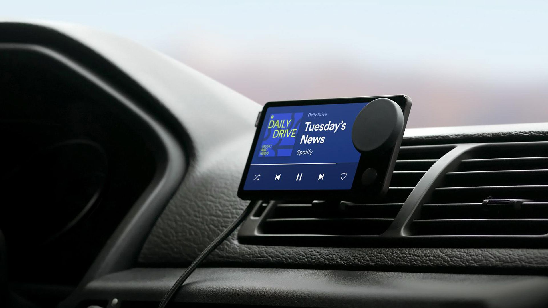 Spotify Car Thing mounted in a car with news playing