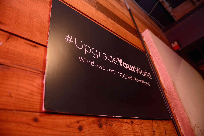 Sign that says #UpgradeYourWorld.
