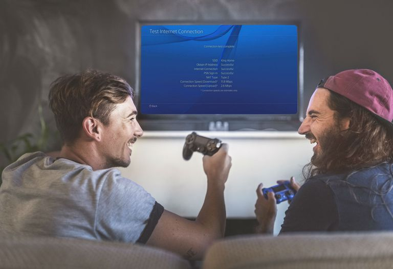 Two men connect their PS4 to a VPN and successfully verify the internet connection.