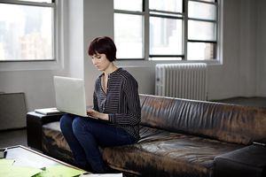 Portrait of young businesswoman working on laptop
