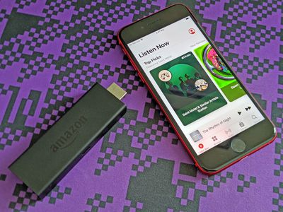 A Fire TV Stick and an iPhone with Apple Music