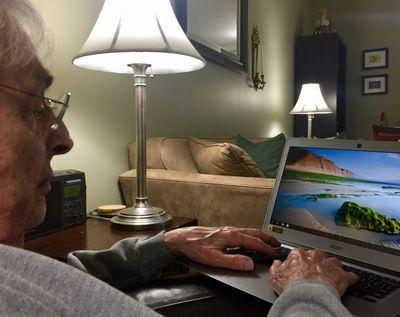 A mature man using a Chromebook.