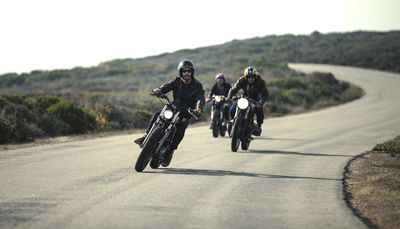 Group of motorcyclists on a country road