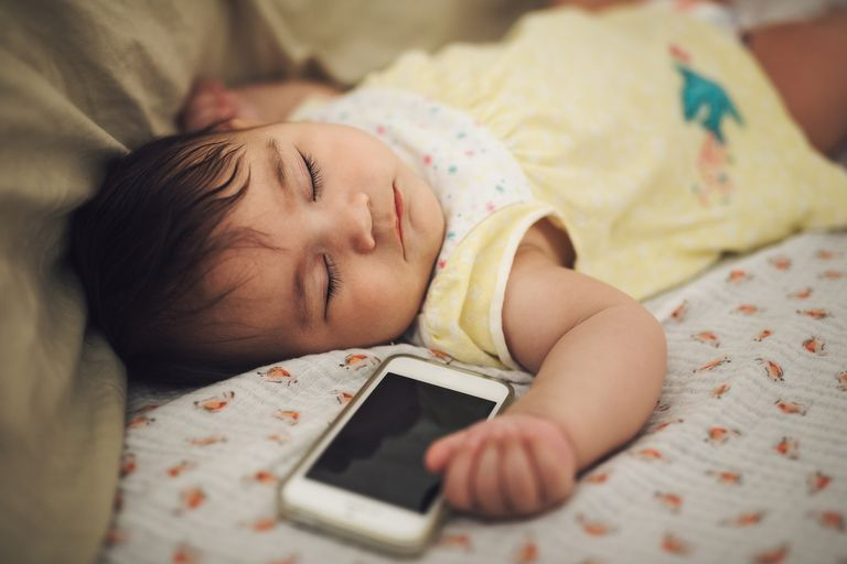 Sleeping baby near a mobile phone