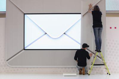 People building big display envelope