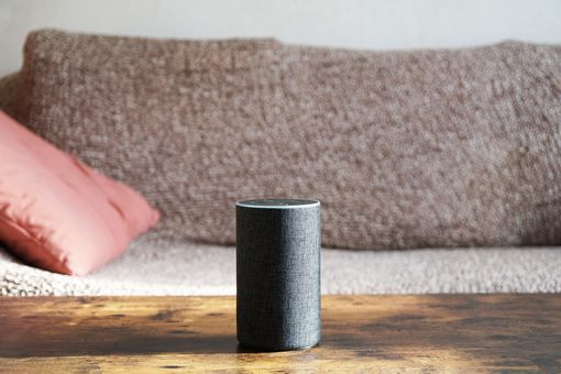 An Amazon Echo speaker on a living room table