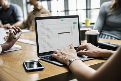 Woman accessing email in workplace setting