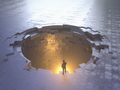 A man examining an illustrated glowing metal hole