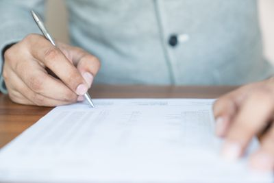 Business owner signing documents