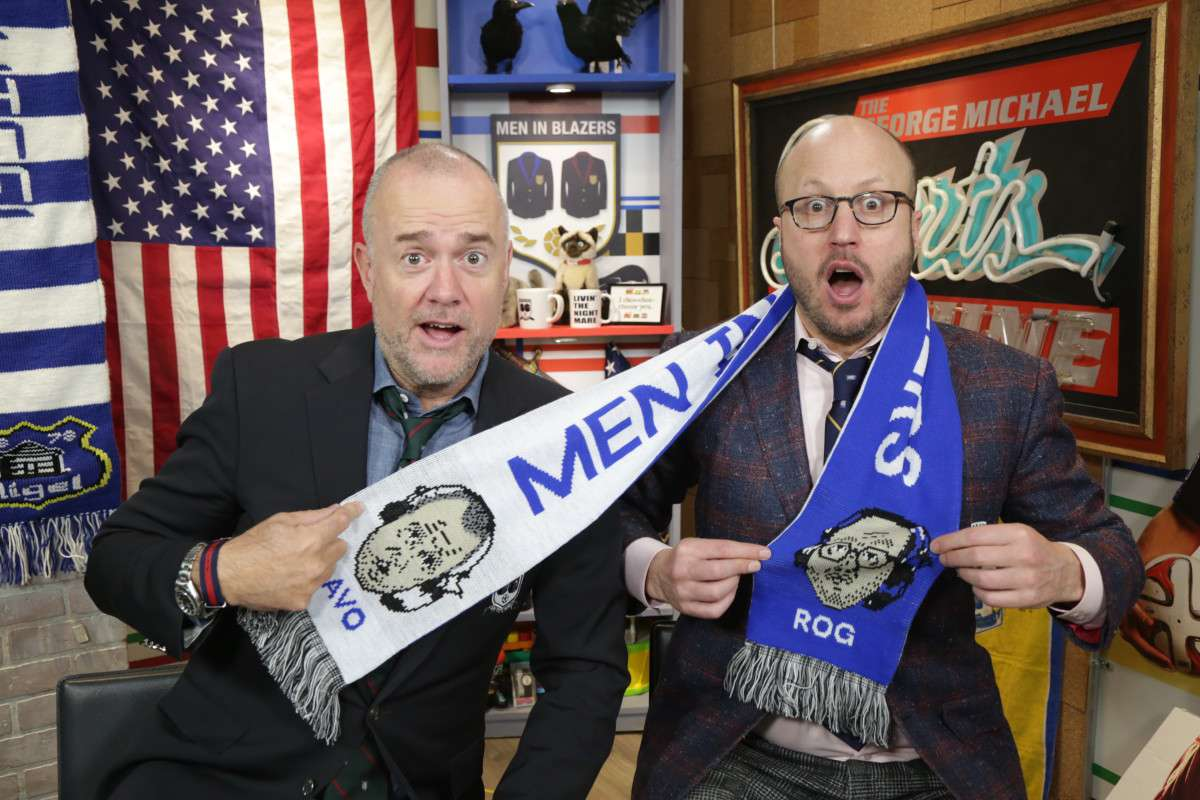Men in Blazer's Rog and Davo display a fan-made scarf