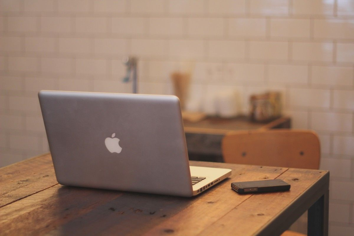 Apple MacBook on a kitchen table