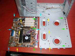 A motherboard and the motherboard tray side-by-side with mounting locations noted