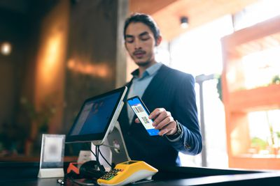Someone using a smartphone for contactless payments.
