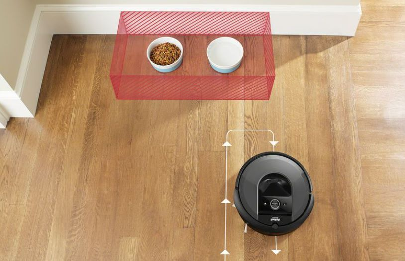 Roomba using AI to avoid dog bowls on a floor.