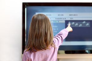 Child in front of television learning app