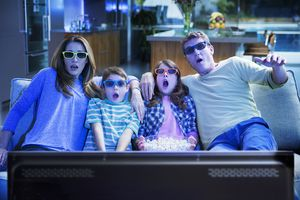 Family watching 3D TV