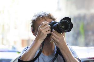 Person using a DSLR camera