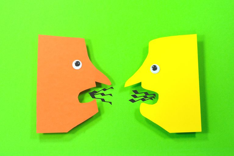 Two figures of cutout faces talking for cut out animation