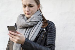 Frustrated woman using her smartphone