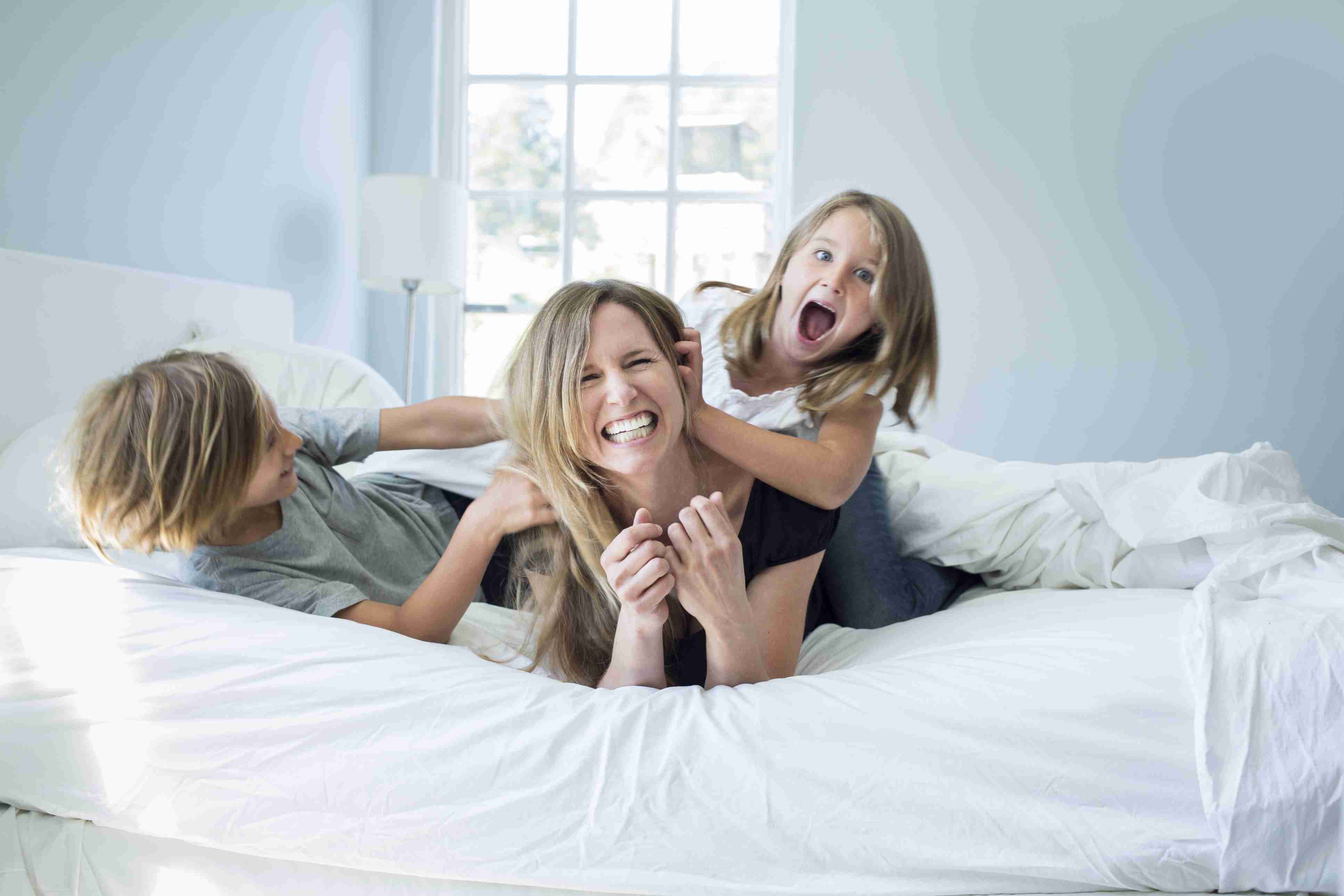 Getty_mom_kids_laughing_bed_large.jpg