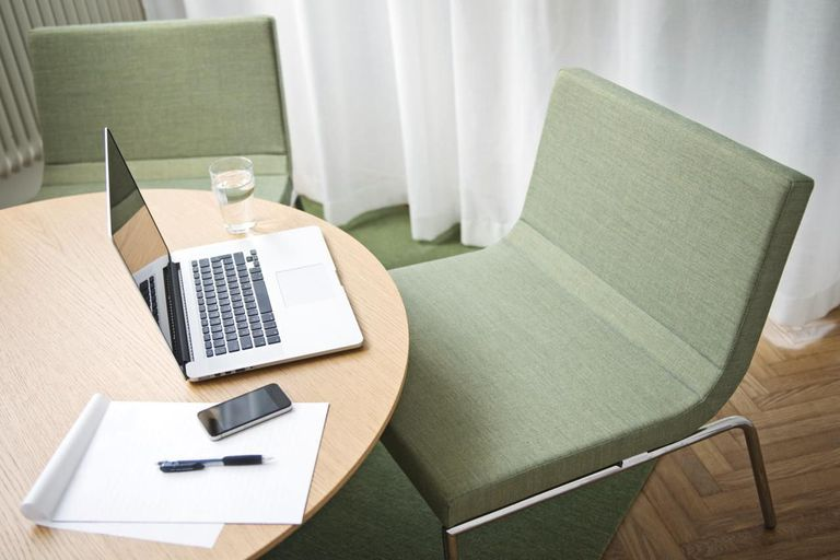 Laptop on table in a conference room