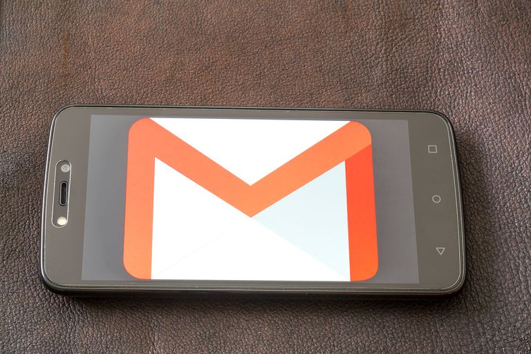 The logo of the Gmail is on the smartphone screen.