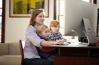 Children on computer with mother