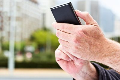 Hands touch the screen on a modern cellphone