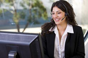 Customer service representative using headset at desktop