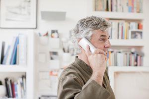 Man talking on handset in home