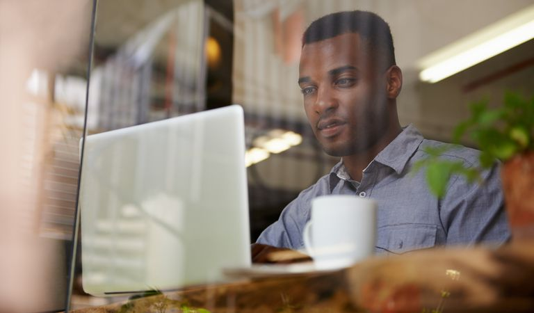Man on laptop in Coffee shop