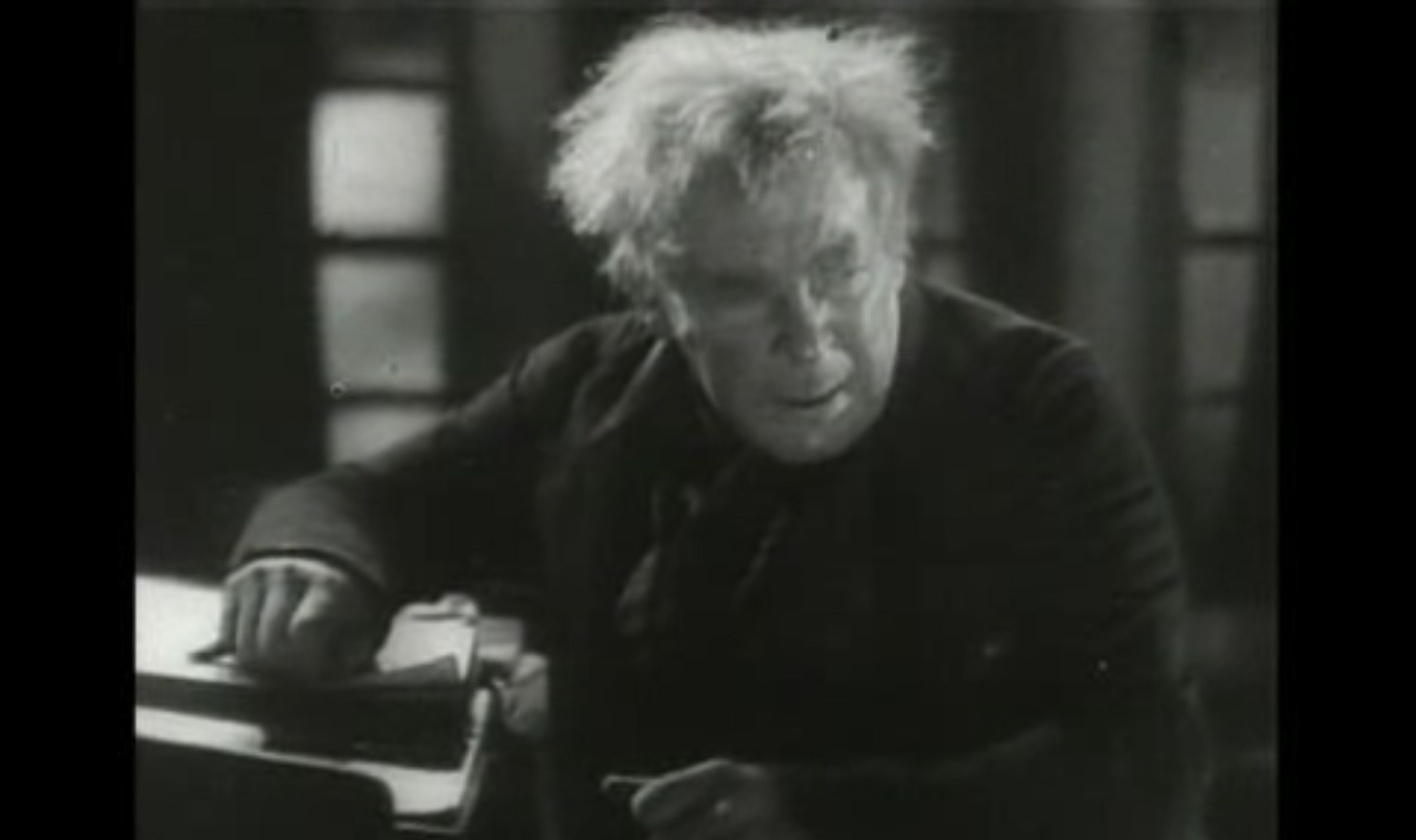 A still image of Scrooge.