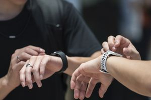 Two people using Apple Watches