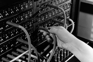 Switchboard with hand holding a switch in black and white