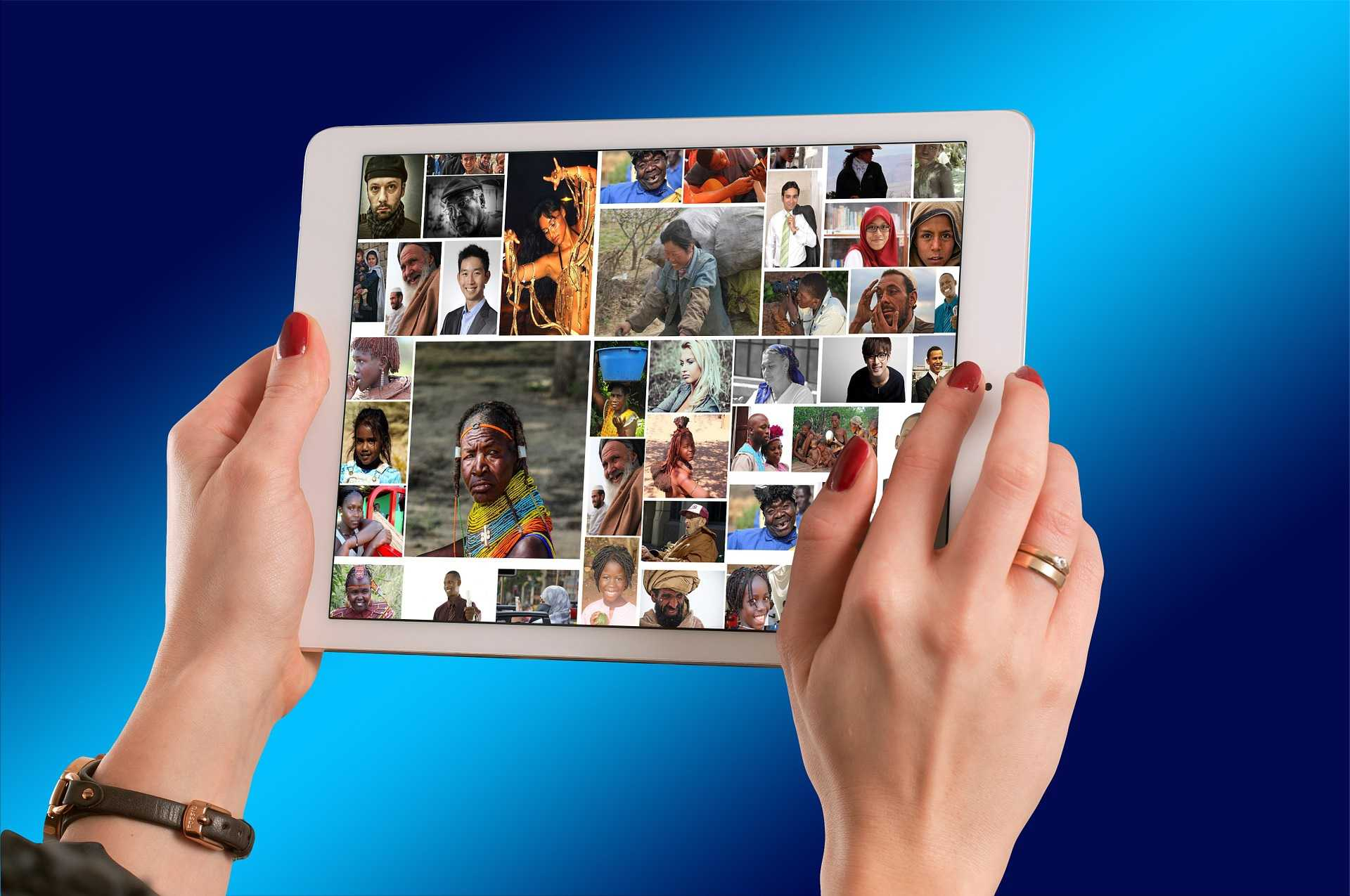 Hands holding an iPad