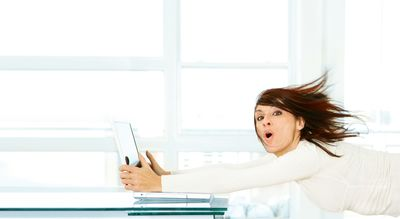Woman being blown off her feet by High Speed Internet
