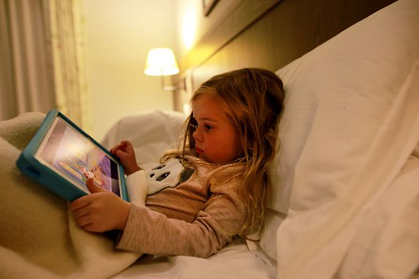 A child playing on an iPad